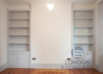 Two fitted white bookcases front view
