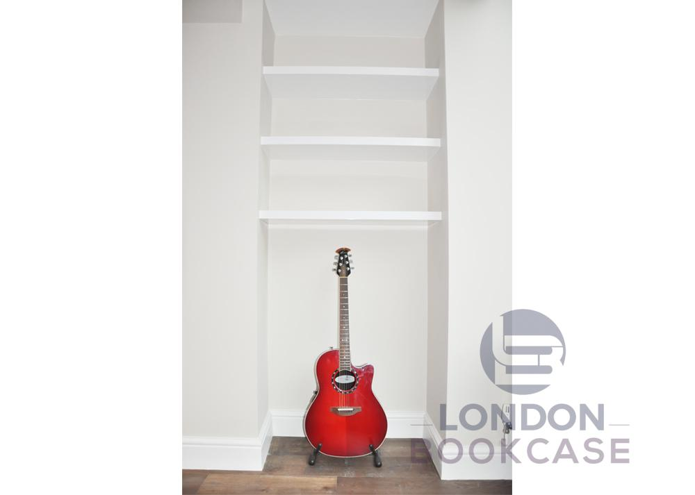 alcove floating shelves with guitar