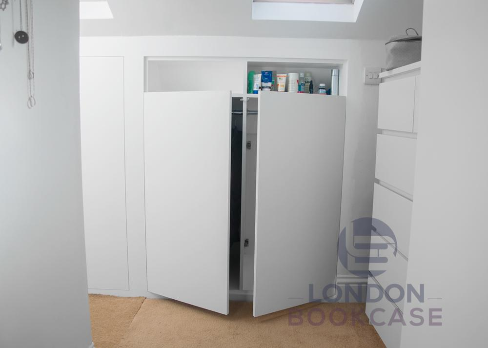 bespoke built-in cupboard in the loft