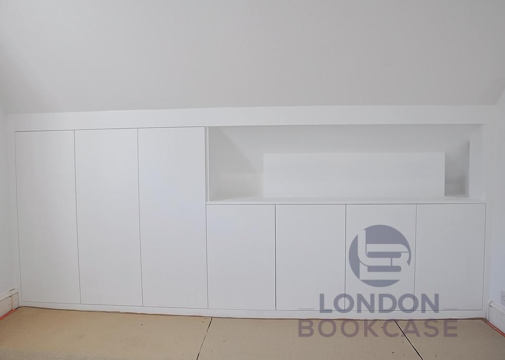 bespoke built-in loft cupboard with recessed niche