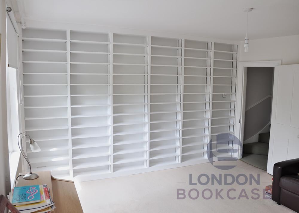 bespoke fitted white bookshelves
