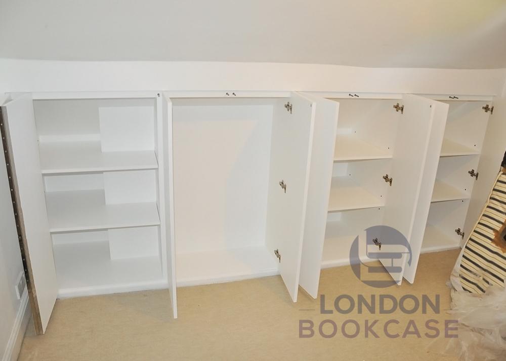 built-in loft storage cupboards inside