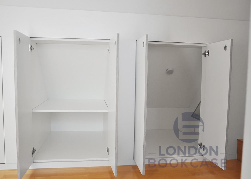built-in loft cupboard storage system inside