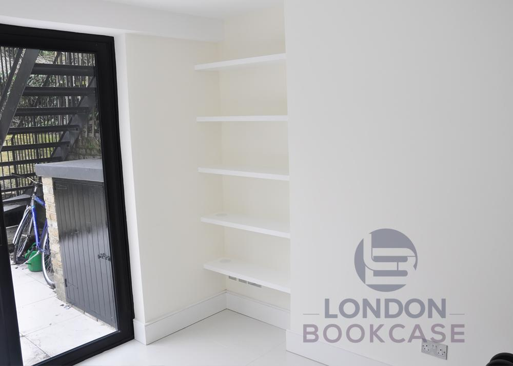 fitted alcove bookshelves
