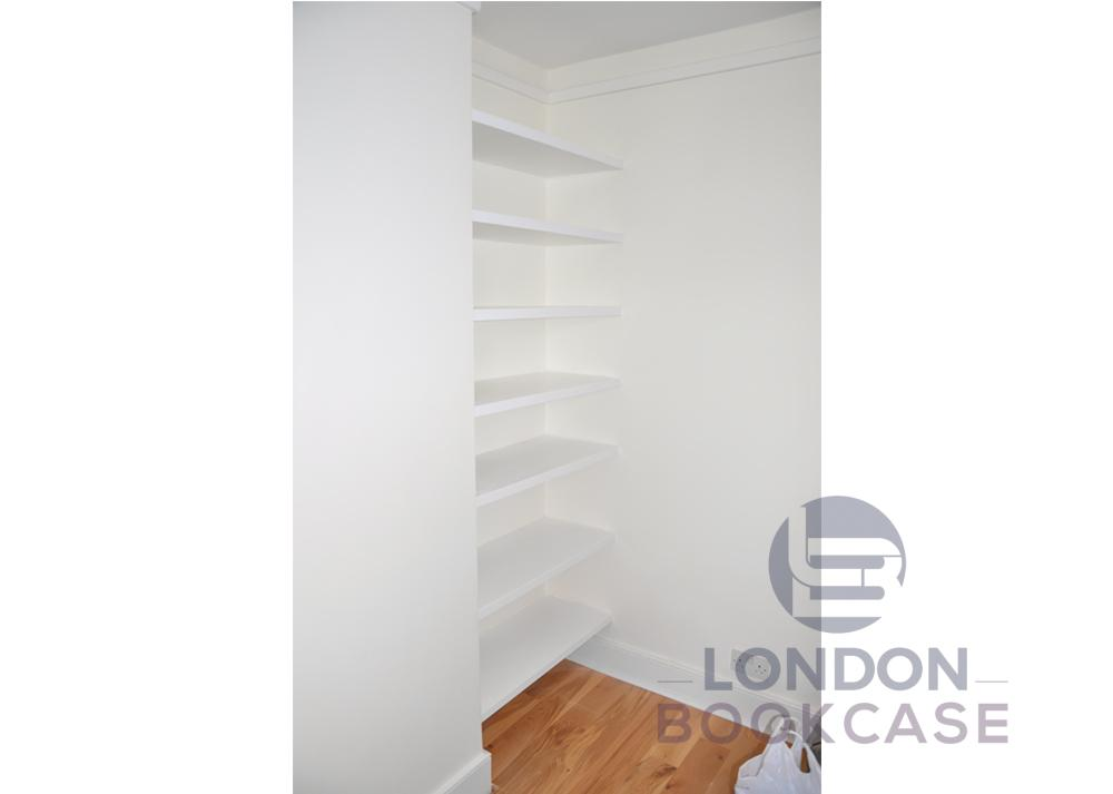 fitted bookshelves in alcove