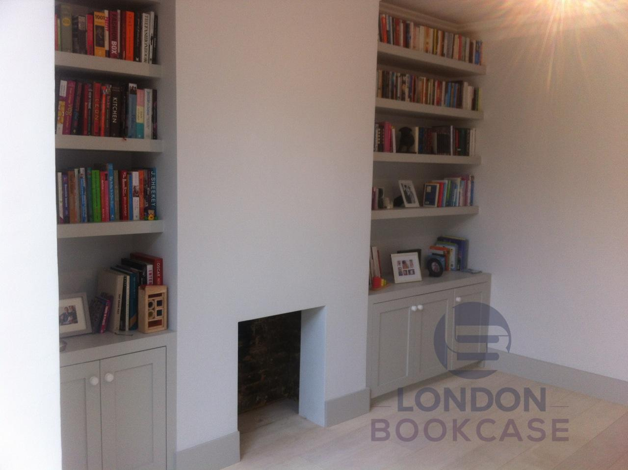 fitted floating bookshelves with books