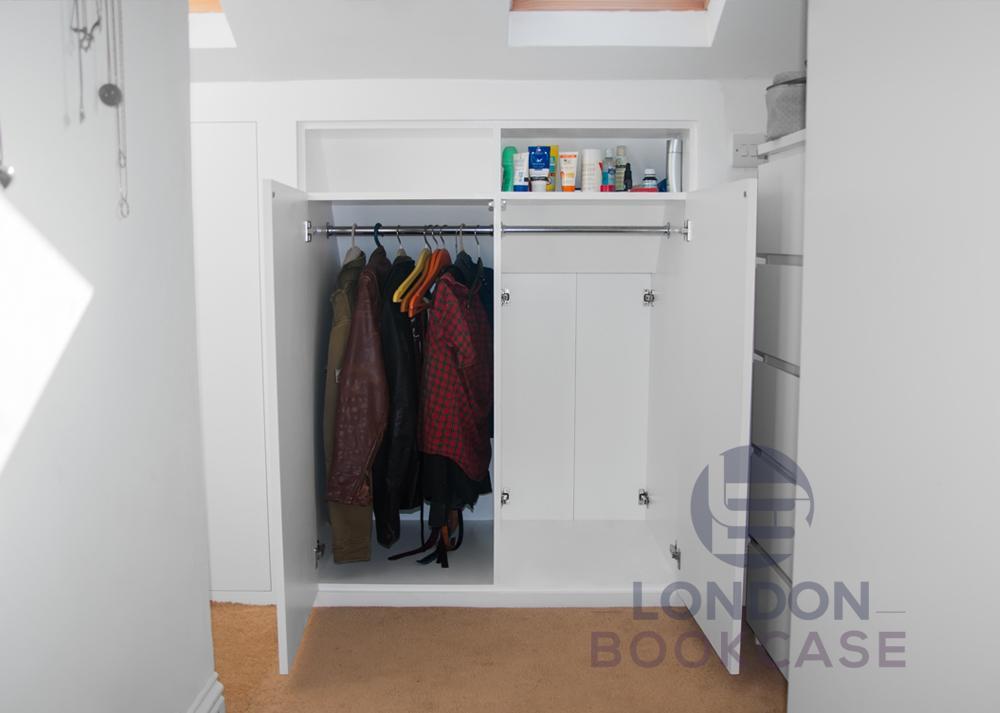 Loft fitted cupboard with secret door