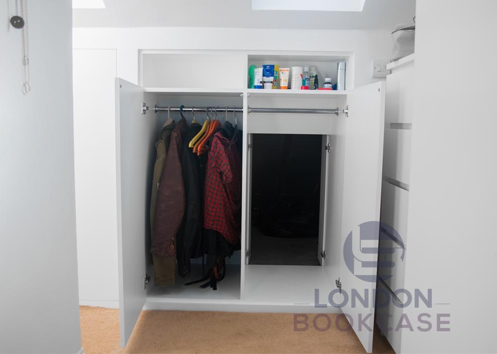 fitted loft cupboard with secret door open