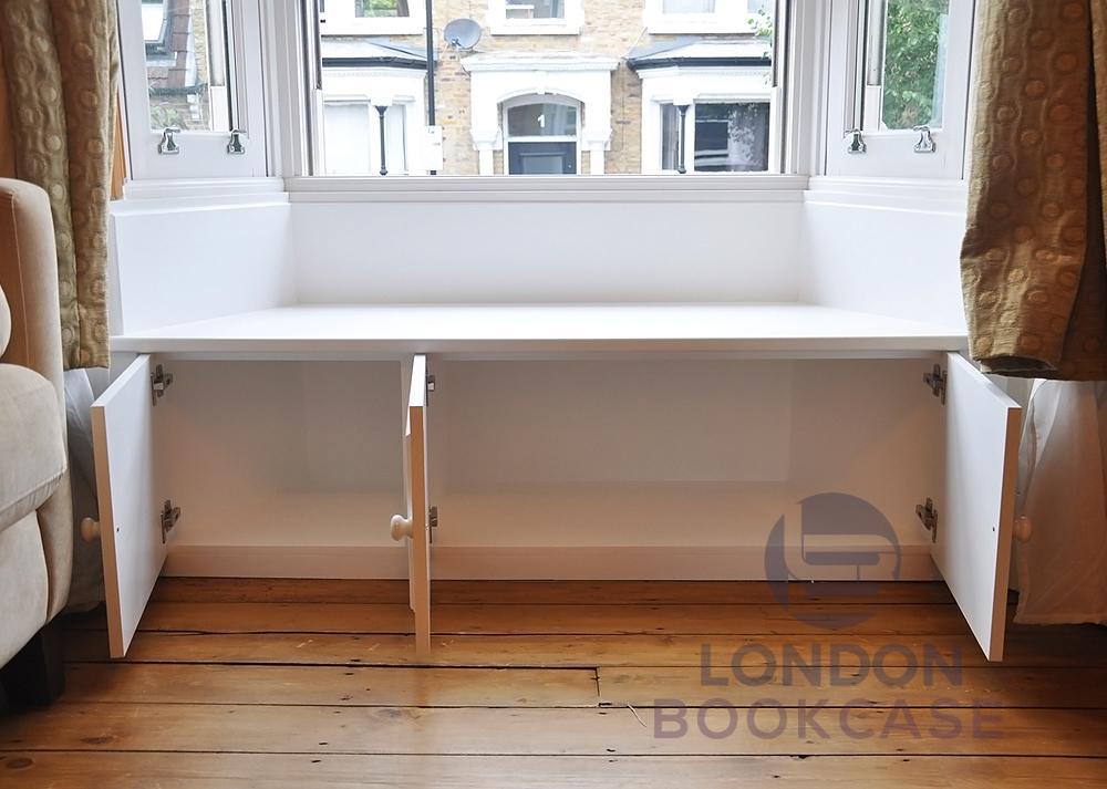window bench seat with storage doors open