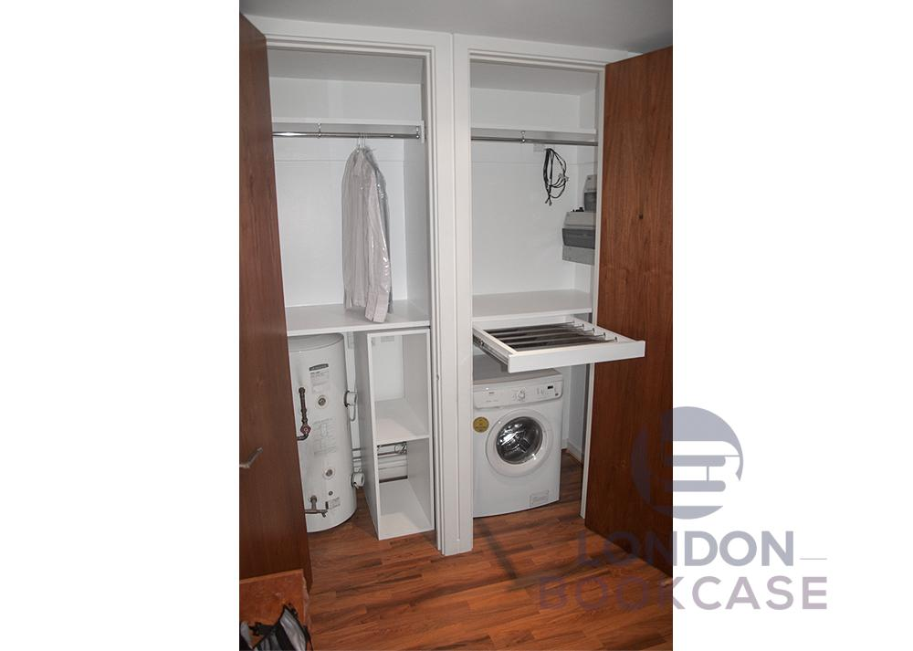 fitted washing machine cupboard with hanging rail