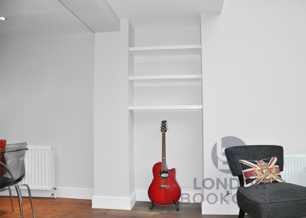 guitar and fitted alcove shelves
