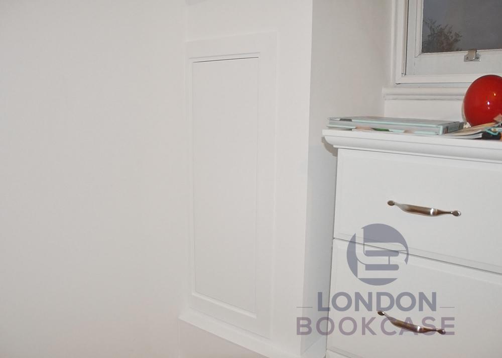 hidden cupboard with closed door