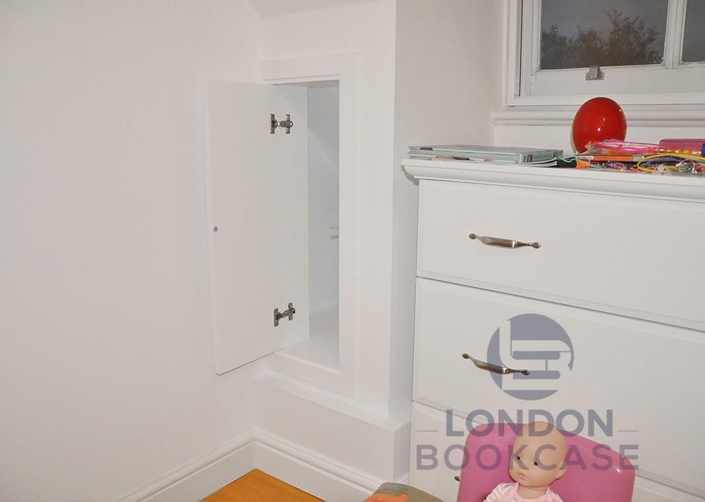 hidden cupboard with push to open door