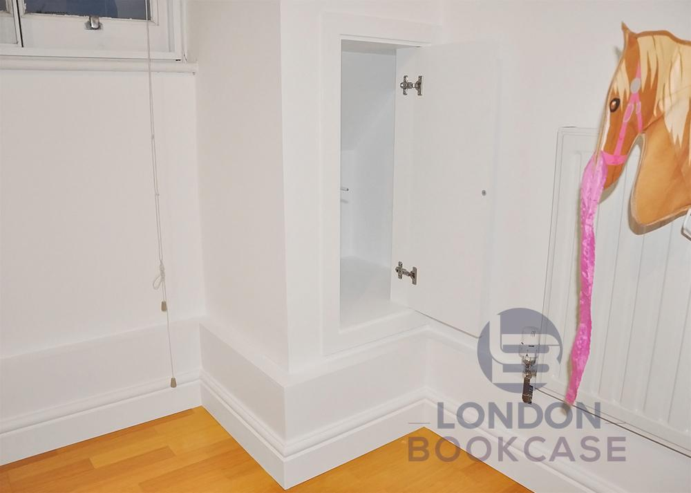 hidden storage cupboard open