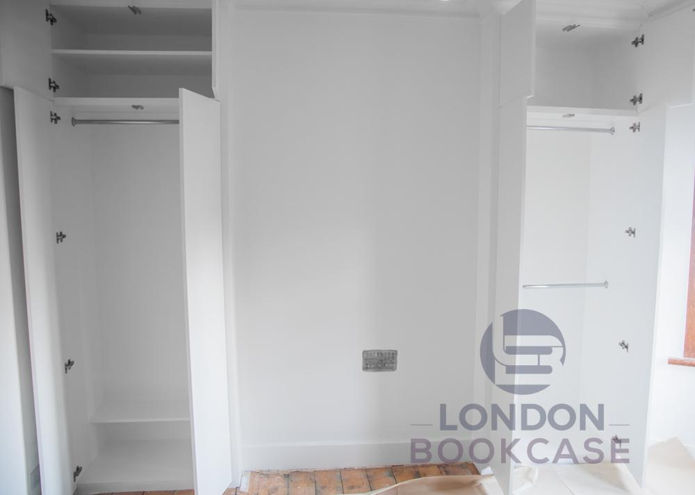 two fitted wardrobes cupboards with open doors