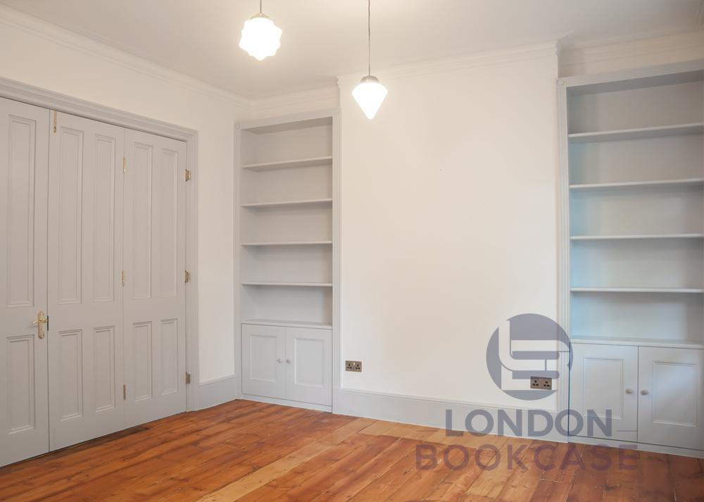 two fitted alcove bookcases
