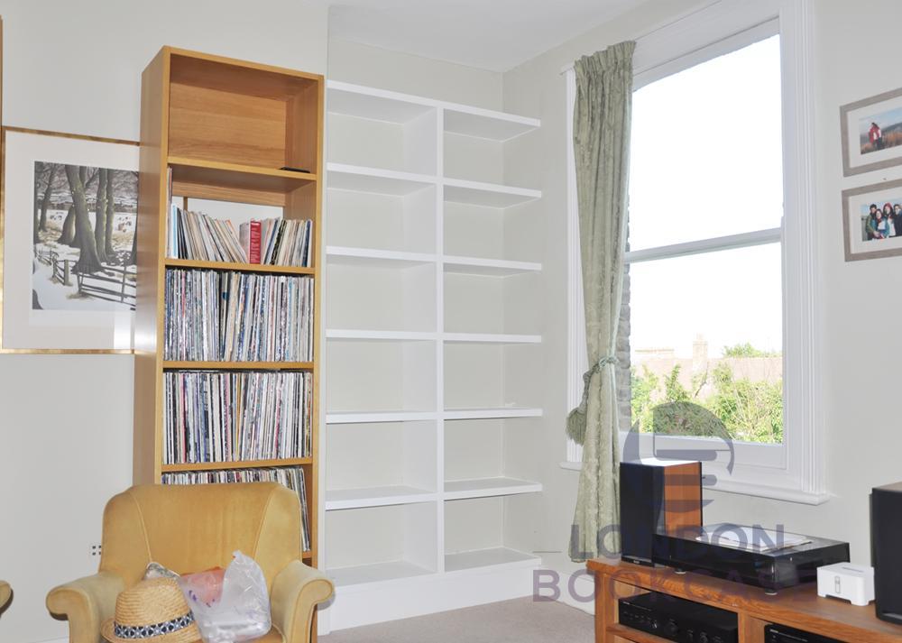 white built-in floating bookshelves