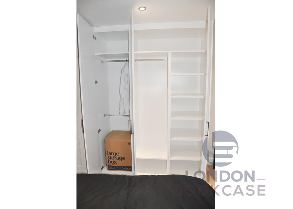 white fitted wardrobe with handles open