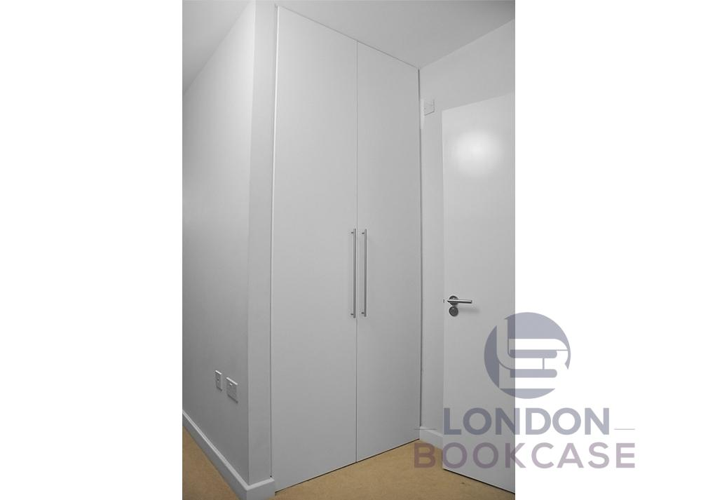 floor to ceiling white fitted wardrobe