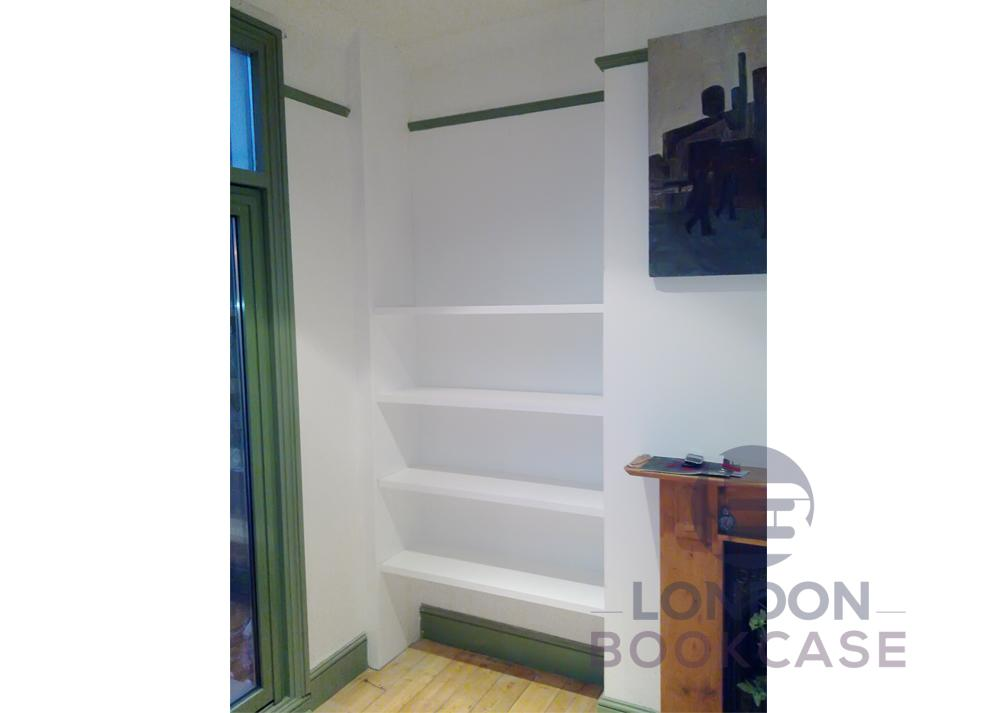 white floating shelves in alcove