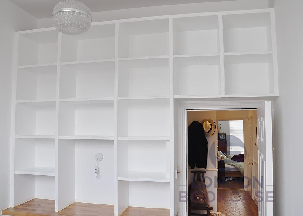 white storage cupboard with shelves